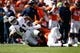 Sep 16, 2018; Denver, CO, USA; Oakland Raiders fullback Keith Smith (41) is pulled down by Denver Broncos inside linebacker Todd Davis (51) and inside linebacker Brandon Marshall (54) in the first quarter at Broncos Stadium at Mile High. Mandatory Credit: Isaiah J. Downing-USA TODAY Sports