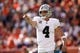 Sep 16, 2018; Denver, CO, USA; Oakland Raiders quarterback Derek Carr (4) motions in the second quarter against the Denver Broncos at Broncos Stadium at Mile High. Mandatory Credit: Isaiah J. Downing-USA TODAY Sports
