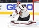 Sep 16, 2018; Las Vegas, NV, USA; Arizona Coyotes goaltender Darcy Kuemper (35) makes a second period save against the Vegas Golden Knights at T-Mobile Arena. Mandatory Credit: Stephen R. Sylvanie-USA TODAY Sports