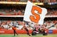 Sep 15, 2018; Syracuse, NY, USA; A Syracuse Orange cheerleader and mascot Otto perform on the field prior to the game against the Florida State Seminoles at the Carrier Dome. Mandatory Credit: Rich Barnes-USA TODAY Sports