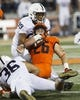 Sep 21, 2018; Champaign, IL, USA; Illinois Fighting Illini running back Mike Epstein (26) is tackled by Penn State Nittany Lions defensive end Yetur Gross-Matos (99) during the first quarter at Memorial Stadium. Mandatory Credit: Mike Granse-USA TODAY Sports