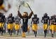 Sep 22, 2018; Hattiesburg, MS, USA; The Southern Miss Golden Eagles mascot runs onto the field before their game against the Rice Owls at M. M. Roberts Stadium. Mandatory Credit: Chuck Cook-USA TODAY Sports