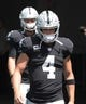 Sep 23, 2018; Miami Gardens, FL, USA; Oakland Raiders quarterback Derek Carr (4) enters the field before a game against the Miami Dolphins at Hard Rock Stadium. Mandatory Credit: Kirby Lee-USA TODAY Sports