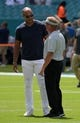 Sep 23, 2018; Miami Gardens, FL, USA; Jason Taylor (left) and Oakland Raiders head coach Jon Gruden talk before a game against the Miami Dolphins at Hard Rock Stadium. Mandatory Credit: Kirby Lee-USA TODAY Sports