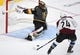 Sep 24, 2018; Las Vegas, NV, USA; Vegas Golden Knights goaltender Malcolm Subban (30) lunges to make a save against Colorado Avalanche left wing A.J. Greer (24) during the second period at T-Mobile Arena. Mandatory Credit: Stephen R. Sylvanie-USA TODAY Sports