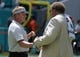 Sep 23, 2018; Miami Gardens, FL, USA; Oakland Raiders head coach Jon Gruden (left) shakes hands with general manager Reggie McKenzie before the game against the Miami Dolphins at Hard Rock Stadium. Mandatory Credit: Kirby Lee-USA TODAY Sports