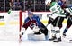 Sep 26, 2018; Denver, CO, USA; Dallas Stars left wing Michael Mersch (20) attempts a shot against Colorado Avalanche goaltender Semyon Varlamov (1) in the first period at Pepsi Center. Mandatory Credit: Ron Chenoy-USA TODAY Sports