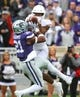 Sep 29, 2018; Manhattan, KS, USA; Kansas State Wildcats defensive back Kendall Adams (21) breaks up a pass intended for Texas Longhorns wide receiver Jerrod Heard (13) during the first quarter at Bill Snyder Family Stadium. Mandatory Credit: Scott Sewell-USA TODAY Sports