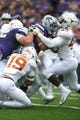 Sep 29, 2018; Manhattan, KS, USA; Kansas State Wildcats running back Alex Barnes (34) is tackled by Texas Longhorns linebacker Anthony Wheeler (45) and defensive back Brandon Jones (19) during the second quarter at Bill Snyder Family Stadium. Mandatory Credit: Scott Sewell-USA TODAY Sports