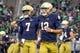 Sep 29, 2018; South Bend, IN, USA; Notre Dame Fighting Irish quarterback Brandon Wimbush (7) and quarterback Ian Book (12) warm up before a game against the Stanford Cardinal at Notre Dame Stadium. Mandatory Credit: Matt Cashore-USA TODAY Sports