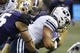 Sep 29, 2018; Seattle, WA, USA; Washington Huskies linebacker Ben Burr-Kirven (25) strips the ball from Brigham Young Cougars running back Lopini Katoa (4) fora  fumble during the second quarter at Husky Stadium. Mandatory Credit: Jennifer Buchanan-USA TODAY Sports