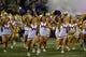 Sep 22, 2018; Seattle, WA, USA; The Washington Huskies cheerleaders run out onto the field before the start of a game against the Arizona State Sun Devils at Husky Stadium. Mandatory Credit: Jennifer Buchanan-USA TODAY Sports