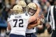Oct 6, 2018; Colorado Springs, CO, USA; Navy Midshipmen center Ford Higgins (72) and wide receiver Aleksei Yaramus (85) celebrate after a  touchdown by quarterback Garret Lewis (right) in the second quarter against the Air Force Falcons at Falcon Stadium. Mandatory Credit: Isaiah J. Downing-USA TODAY Sports
