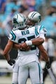 Oct 7, 2018; Charlotte, NC, USA; Carolina Panthers quarterback Cam Newton (1) hugs new teammate Carolina Panthers defensive back Eric Reid (25) during the first quarter against the New York Giants at Bank of America Stadium. Mandatory Credit: Jim Dedmon-USA TODAY Sports