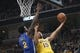 October 12, 2018; San Jose, CA, USA; Los Angeles Lakers forward Johnathan Williams (19) shoots the basketball against Golden State Warriors forward Jordan Bell (2) during the first quarter at SAP Center. Mandatory Credit: Kyle Terada-USA TODAY Sports