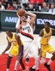 Oct 18, 2018; Portland, OR, USA; Portland Trail Blazers center Jusuf Nurkic (27) shoots over Los Angeles Lakers guard Rajon Rondo (9) and  Lakers guard Kentavious Caldwell-Pope (1) in the second half at Moda Center. Mandatory Credit: Jaime Valdez-USA TODAY Sports