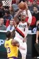 Oct 18, 2018; Portland, OR, USA;  Portland Trail Blazers guard Damian Lillard (0) shoots over Los Angeles Lakers forward LeBron James (23) in the second half at Moda Center. Mandatory Credit: Jaime Valdez-USA TODAY Sports