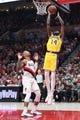 Oct 18, 2018; Portland, OR, USA;  Los Angeles Lakers forward Brandon Ingram (14) shoots the ball over Portland Trail Blazers guard Damian Lillard (0) during the first half at Moda Center. Mandatory Credit: Jaime Valdez-USA TODAY Sports