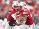 Oct 20, 2018; Madison, WI, USA; Wisconsin Badgers quarterback Alex Hornibrook (12) hands the football off to running back Jonathan Taylor (23) during the first quarter against the Illinois Fighting Illini at Camp Randall Stadium. Mandatory Credit: Jeff Hanisch-USA TODAY Sports