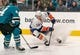 Oct 20, 2018; San Jose, CA, USA; New York Islanders center Mathew Barzal (13) moves the puck against San Jose Sharks defenseman Marc-Edouard Vlasic (44) during the first period at SAP Center at San Jose. Mandatory Credit: Neville E. Guard-USA TODAY Sports