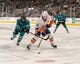 Oct 20, 2018; San Jose, CA, USA; San Jose Sharks left wing Evander Kane (9) defends against the shot of New York Islanders right wing Cal Clutterbuck (15) during the first period at SAP Center at San Jose. Mandatory Credit: Neville E. Guard-USA TODAY Sports