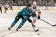 Oct 20, 2018; San Jose, CA, USA; San Jose Sharks center Melker Karlsson (68) moves the puck against New York Islanders left wing Anders Lee (27) during the second period at SAP Center at San Jose. Mandatory Credit: Neville E. Guard-USA TODAY Sports