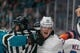 Oct 20, 2018; San Jose, CA, USA; New York Islanders defenseman Scott Mayfield (24) and San Jose Sharks left wing Evander Kane (9) fight during the second period at SAP Center at San Jose. Mandatory Credit: Neville E. Guard-USA TODAY Sports