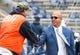 Oct 13, 2018; University Park, PA, USA; Penn State Nittany Lions head coach James Franklin (right) greets a stadium event staff member prior to the game against the Michigan State Spartans at Beaver Stadium. Mandatory Credit: Rich Barnes-USA TODAY Sports