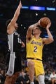 October 22, 2018; Los Angeles, CA, USA; Los Angeles Lakers guard Lonzo Ball (2) moves in to score a basket against San Antonio Spurs guard Bryn Forbes (11) during the first half at Staples Center. Mandatory Credit: Gary A. Vasquez-USA TODAY Sports