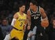 October 22, 2018; Los Angeles, CA, USA; San Antonio Spurs guard DeMar DeRozan (10) moves the ball against Los Angeles Lakers guard Josh Hart (3) during the first half at Staples Center. Mandatory Credit: Gary A. Vasquez-USA TODAY Sports