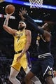 Oct 25, 2018; Los Angeles, CA, USA; Los Angeles Lakers center JaVale McGee (7) attempts a shot wile Denver Nuggets forward Paul Millsap (4) defends during the second half at Staples Center. Mandatory Credit: Kelvin Kuo-USA TODAY Sports