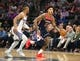 Oct 26, 2018; Sacramento, CA, USA; Washington Wizards forward Kelly Oubre Jr. (12) drives down the court against Sacramento Kings guard Frank Mason III (10) during the first quarter at Golden 1 Center. Mandatory Credit: Kelley L Cox-USA TODAY Sports