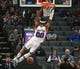 Oct 26, 2018; Sacramento, CA, USA; Sacramento Kings center Willie Cauley-Stein (00) hangs on the rim after a dunk against the Washington Wizards during the first quarter at Golden 1 Center. Mandatory Credit: Kelley L Cox-USA TODAY Sports