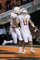 Oct 27, 2018; Stillwater, OK, USA; Texas Longhorns quarterback Sam Ehlinger (11) and Texas Longhorns wide receiver Collin Johnson (9) react after a touchdown against the Oklahoma State Cowboys at Boone Pickens Stadium. Mandatory Credit: Rob Ferguson-USA TODAY Sports