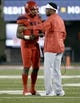 Oct 27, 2018; Tucson, AZ, USA; Arizona Wildcats head coach Kevin Sumlin and quarterback Khalil Tate (14) talk during the first half against the Oregon Ducks at Arizona Stadium. Mandatory Credit: Casey Sapio-USA TODAY Sports
