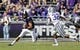 Nov 3, 2018; Fort Worth, TX, USA; Kansas State Wildcats quarterback Skylar Thompson (10) runs as Kansas State Wildcats linebacker Justin Hughes (32) defends during the first quarter at Amon G. Carter Stadium. Mandatory Credit: Kevin Jairaj-USA TODAY Sports
