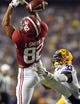 Nov 3, 2018; Baton Rouge, LA, USA; LSU Tigers safety Todd Harris Jr. (33) breaks up a pass intended for Alabama Crimson Tide tight end Irv Smith Jr. (82) during the first quarter at Tiger Stadium. Mandatory Credit: John David Mercer-USA TODAY Sports