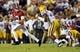 Nov 3, 2018; Baton Rouge, LA, USA; Alabama Crimson Tide quarterback Mac Jones (10) scrambles out of the pocket to pass against the LSU Tigers during the first quarter at Tiger Stadium. Mandatory Credit: John David Mercer-USA TODAY Sports