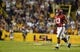 Nov 3, 2018; Baton Rouge, LA, USA; Alabama Crimson Tide quarterback Tua Tagovailoa (13) jogs off the field after being dazed by a hit from the LSU Tigers defense during the first quarter at Tiger Stadium. Mandatory Credit: John David Mercer-USA TODAY Sports