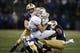 Nov 3, 2018; Seattle, WA, USA; Washington Huskies linebacker Ben Burr-Kirven (25) finishes the tackle on Stanford Cardinal wide receiver Trenton Irwin (2) during the second quarter at Husky Stadium. Mandatory Credit: Jennifer Buchanan-USA TODAY Sports