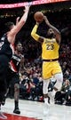 Nov 3, 2018; Portland, OR, USA; Los Angeles Lakers forward LeBron James (23) passes the ball over Portland Trail Blazers center Jusuf Nurkic (27) and forward Al-Farouq Aminu (8)during the second half of the game at the Moda Center. The Lakers won the game 114-110. Mandatory Credit: Steve Dykes-USA TODAY Sports
