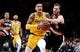 Nov 3, 2018; Portland, OR, USA;Los Angeles Lakers forward Kyle Kuzma (0) drives to the basket on Portland Trail Blazers forward Jake Layman (10) during the second half of the game at the Moda Center. The Lakers won the game 114-110. Mandatory Credit: Steve Dykes-USA TODAY Sports