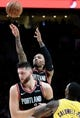 Nov 3, 2018; Portland, OR, USA; Portland Trail Blazers guard Damian Lillard (0) hits a shot as center Jusuf Nurkic (27) sets a pick on Los Angeles Lakers guard Kentavious Caldwell-Pope (1) during the second half of the game at the Moda Center. The Lakers won the game 114-110. Mandatory Credit: Steve Dykes-USA TODAY Sports