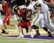 Nov 9, 2018; Cedar Falls, IA, USA; Cedar Falls Tigers Sam Gary (19) is tackled by Southeast Polk Rams Zach Strickland (25) and Southeast Polk Rams Brady Lyons (40) at the UNI Dome. The Rams lost to the Tigers 26-12.  Ncaa Football Texas Tech At Iowa State