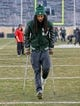 Nov 24, 2018; East Lansing, MI, USA; Injured senior wide receiver Felton Davis (18) walks off the field for the final time prior to a game against the Rutgers Scarlet Knights at Spartan Stadium. Mandatory Credit: Mike Carter-USA TODAY Sports