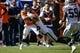 Sep 16, 2018; Denver, CO, USA; Oakland Raiders safety Erik Harris (25) tackles Denver Broncos running back Phillip Lindsay (30) in the second quarter at Broncos Stadium at Mile High. Mandatory Credit: Isaiah J. Downing-USA TODAY Sports