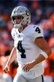 Sep 16, 2018; Denver, CO, USA; Oakland Raiders quarterback Derek Carr (4) in the second quarter against the Denver Broncos at Broncos Stadium at Mile High. Mandatory Credit: Isaiah J. Downing-USA TODAY Sports
