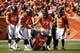 Sep 16, 2018; Denver, CO, USA; Denver Broncos offensive guard Connor McGovern (60) looks on as center Matt Paradis (61) and offensive tackle Garett Bolles (72) and running back Devontae Booker (23) help quarterback Case Keenum (4) up from the ground after a play in the second quarter against the Oakland Raiders at Broncos Stadium at Mile High. Mandatory Credit: Isaiah J. Downing-USA TODAY Sports