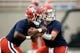 Sep 1, 2018; Colorado Springs, CO, USA; Stony Brook Seawolves quarterback Jack Cassidy (9) and running back Kameron Pickett (1) warmup before the game against the Air Force Falcons at Falcon Stadium. Mandatory Credit: Isaiah J. Downing-USA TODAY Sports