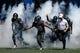 Sep 1, 2018; Colorado Springs, CO, USA; Air Force Falcons running back Joshua Stoner (22) and fullback Taven Birdow (33) and head coach Troy Calhoun lead the team onto the field before the game against the Stony Brook Seawolves at Falcon Stadium. Mandatory Credit: Isaiah J. Downing-USA TODAY Sports